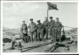 Bronowski with 5 others, all wearing uniform and standing on a ship