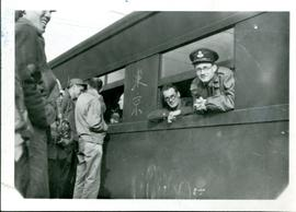 "Photograph of Francis Walley and others on a train ""arriving in North Island Nov 1945"" ..."
